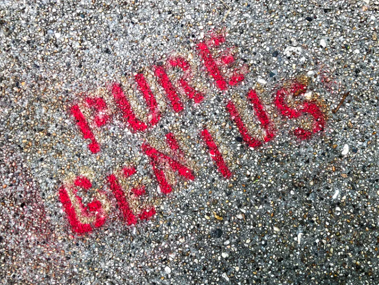 Pure Genius, stenciled on pavement. By Lance Grandahl for Unsplash.