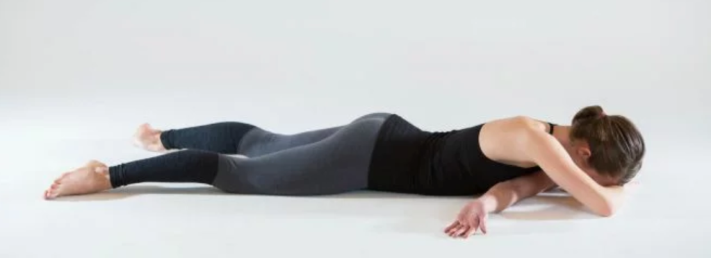 Sort of a shoulder shoelace pose. Lie face down and thread one arm underneath and through. bend other arm and lie with head resting on it.