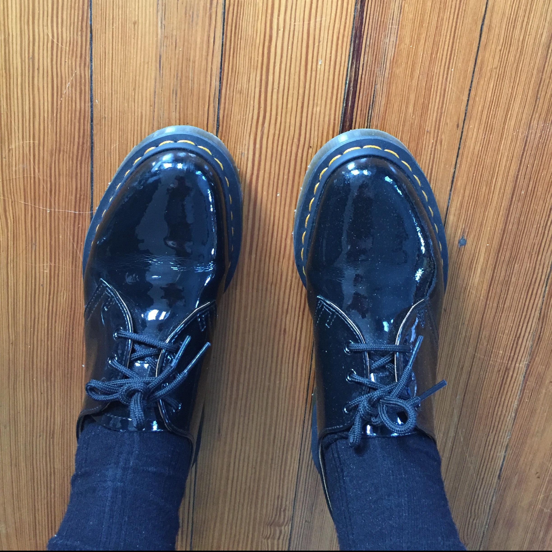 Black patent-leather Doc Martens.
