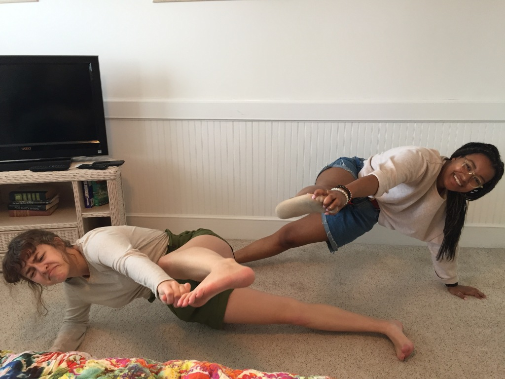 Gracie and Bethie doing side plank, each making big toe contact, but at some cost...