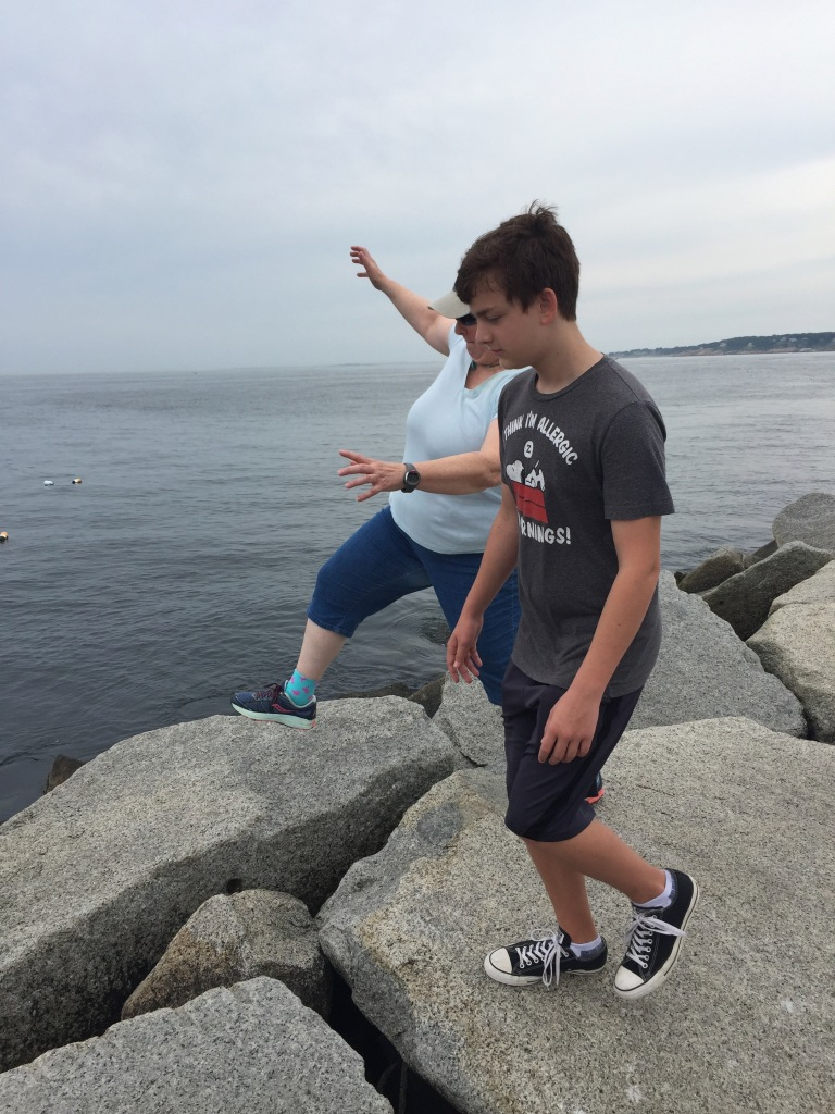 Silly walking on the jetty in Gloucester with Gray.