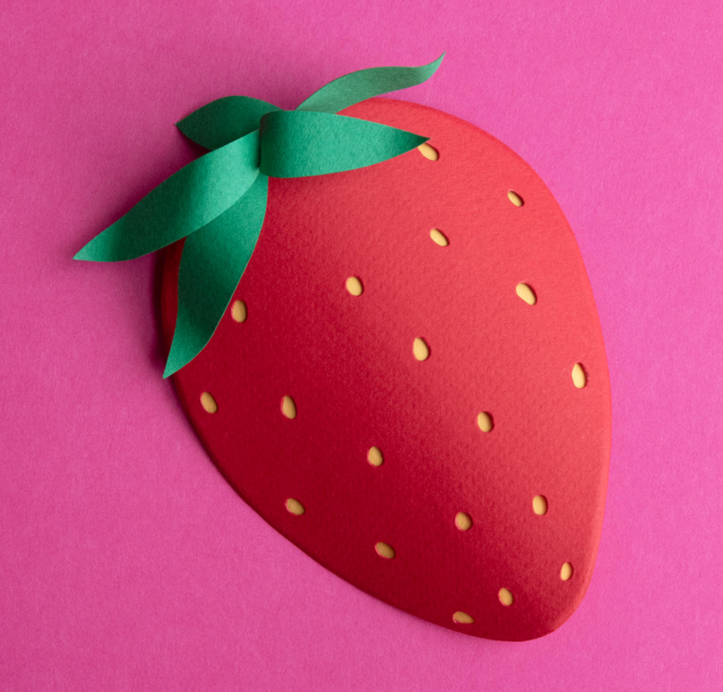 A gorgeous huge strawberry on a pink background, MADE OF PAPER!