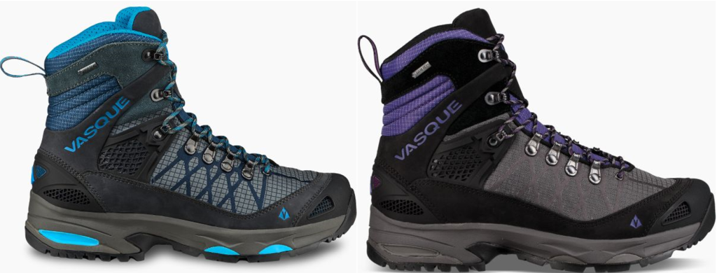 "Two hiking boots displayed in profile. One is black, grey, and turquoise and the other is black, grey, and purple. The turquoise boot has three semicircular turquoise accents along the side of the sole. The brand name ""Vasque"" is visible next to the laces on each boot."