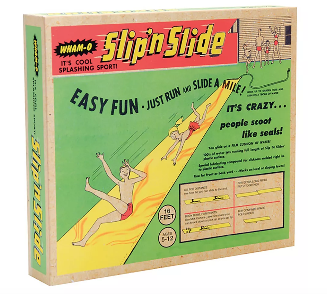 Vintage Slip 'n Slide box, with  drawings of white kids sliding on a wet piece of plastic on grass.