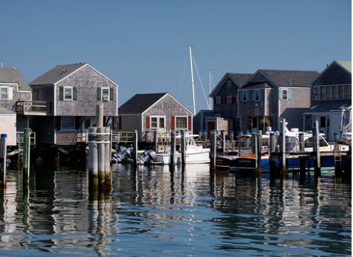 Cedar-shingled dwellings on the docks by the Nantucket marina.