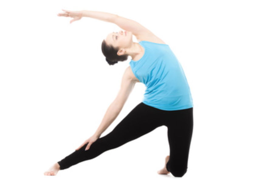 Woman kneeling and stretching. This one feels good, no matter what your range of motion.
