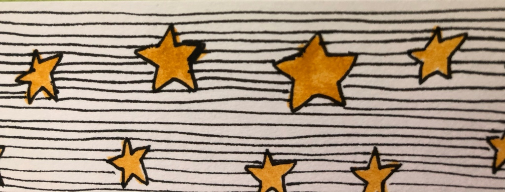 Image description: 8 hand-drawn gold stars of various sizes with a background of black lines drawn on white paper.​