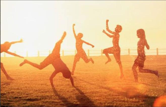 Kids playing in golden sunlight/