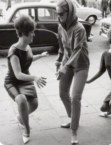 Two women dancing the twist in 1962.