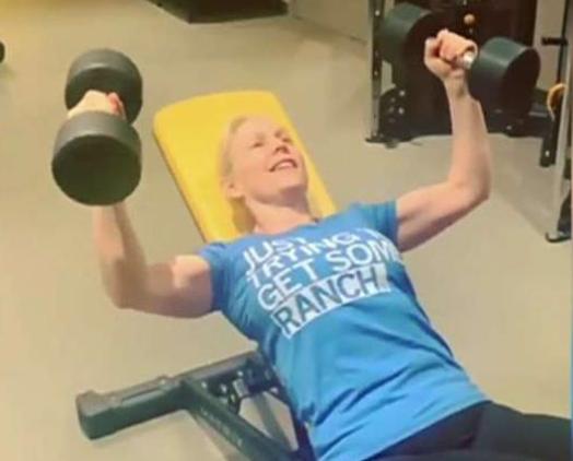 NY Senator Kirsten Gillibrand, lifting weights.