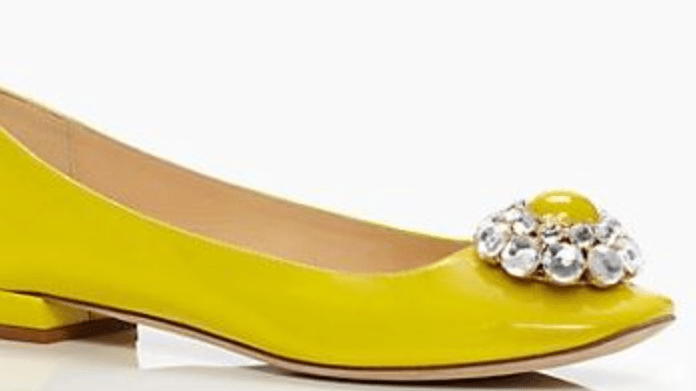 Yellow flat with gaudy rhinestone-y bauble on the toe