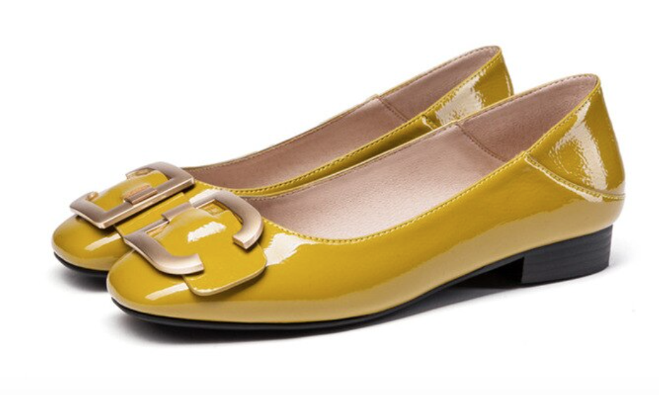 A mustardy yellow low-heel number with brassy buckles.