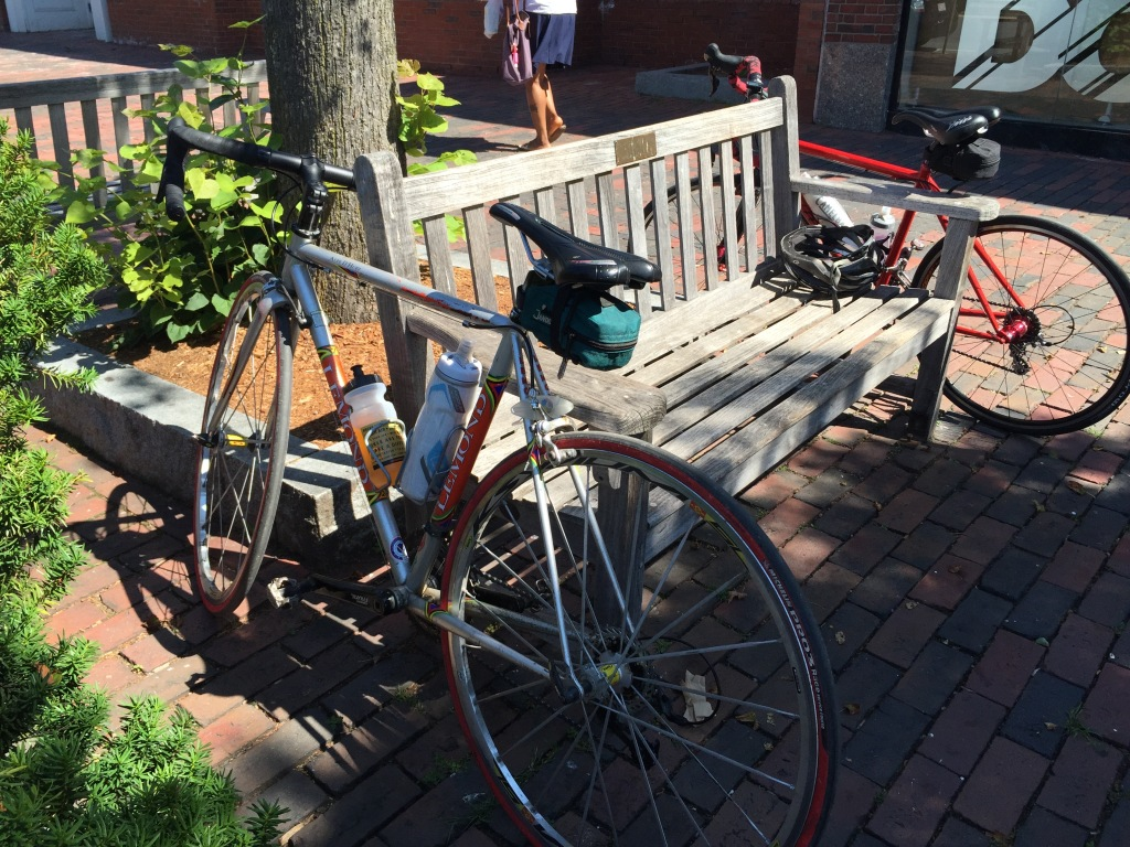 Two road bikes-- mine in foreground, Pata's in back, relaxing while their owners stop for coffee on a fine summer Friday. To be resumed...