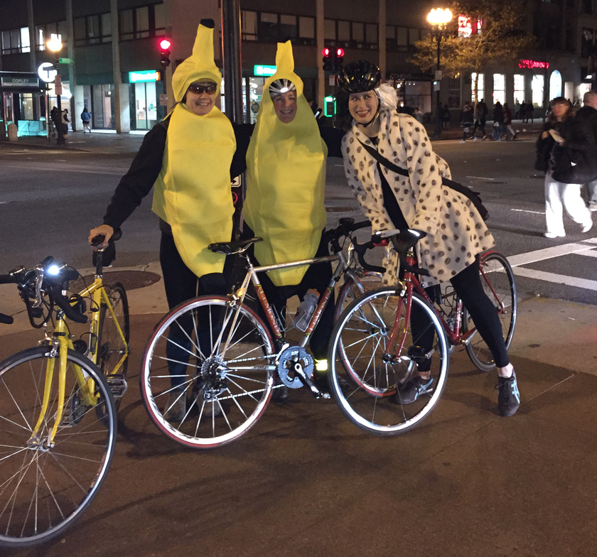 Rachel and me in banana outfits, and Steph as Cruella, on wheels for Halloween.