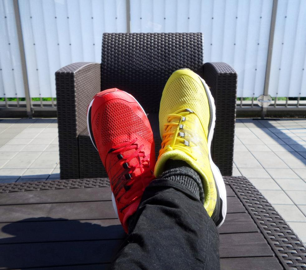 A person wearing one red sneaker and one yellow sneaker. by Unsplash.