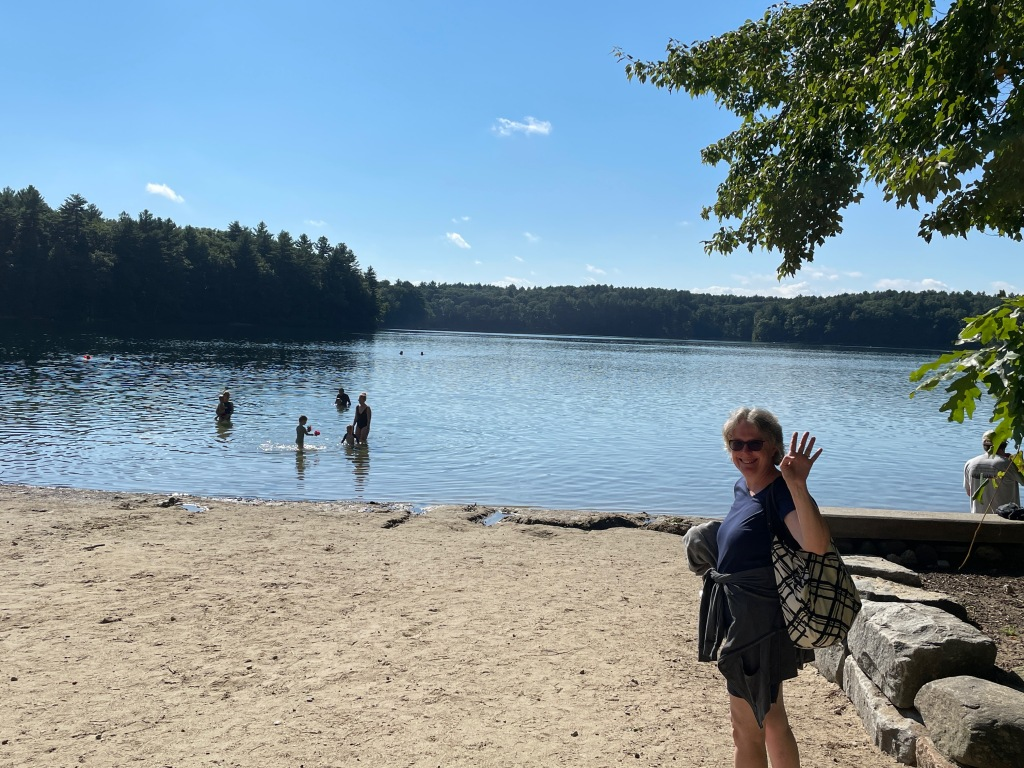 Norah on the main beach of Walden, waving to all of you.