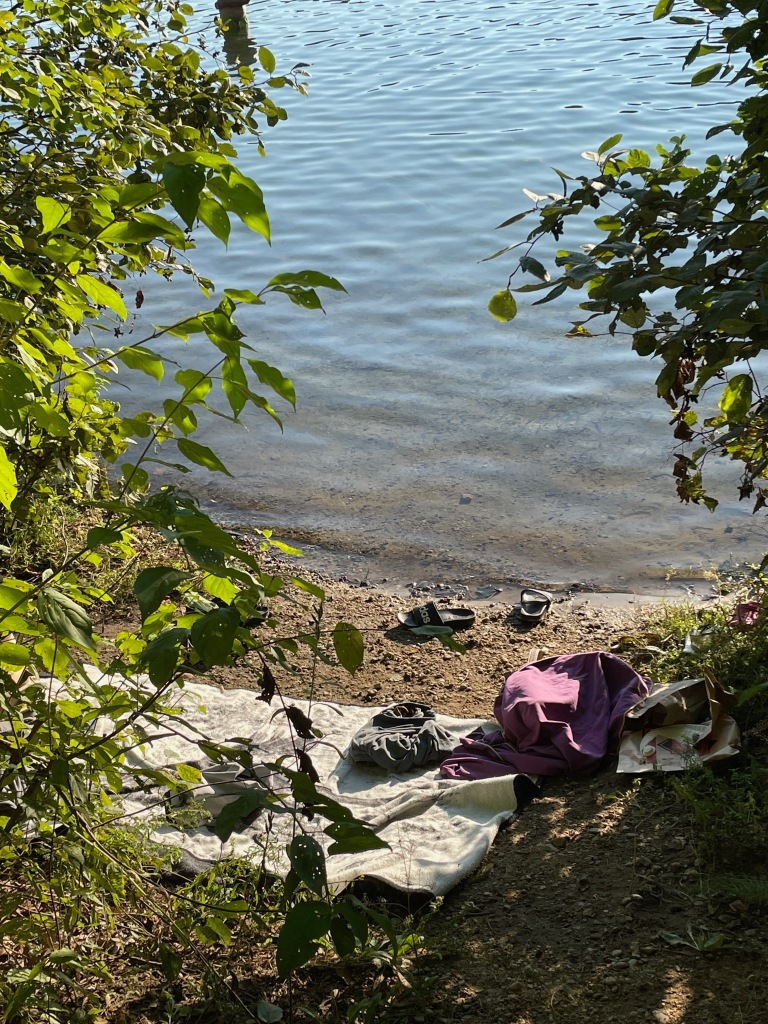 Some staked out a great waterside spot with a towel, clothing, slides.